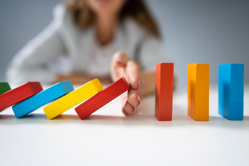 Fototapeta Businessperson Hand Stopping Colorful Blocks From Falling obraz