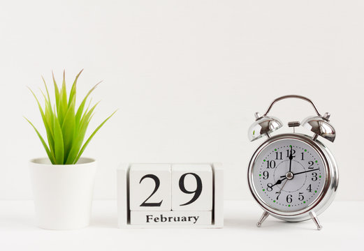 February 29 on a wooden calendar next to the alarm clock.Calendar date, holiday event or birthday.The last day of the winter month. February 29 happens every four years.