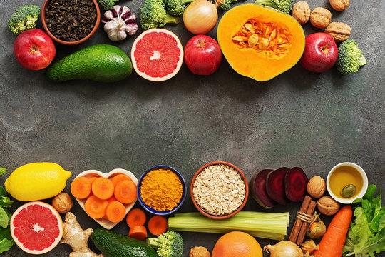Liver detox diet food concept, border. Fruits,vegetables, nuts, olive oil, citrus fruits, green tea, turmeric, oats. Top view, flat lay,frame.