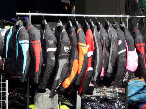 KUALA LUMPUR, MALAYSIA -SEPTEMBER 09, 2017: Motorcycle riding jackets hanging for sale.  Special safety feature for motorcycle rider was added to this jacket design.
