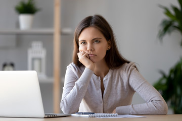 Tired young woman feel bored working at laptop