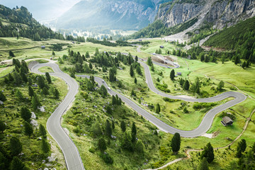 Winding road and green hills, Passo Gardena, Dolomites, aerial view Wall mural