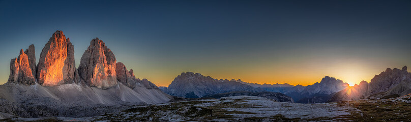 Panorama of Tre Cime peaks in Dolomites at sunset, Italy