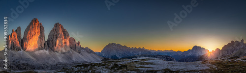 Wall mural Panorama of Tre Cime peaks in Dolomites at sunset, Italy
