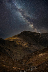 Photo sur Plexiglas Marron chocolat Stunning majestic digital composite landscape of Milky Way over Haystacks and High Stile in Lake District