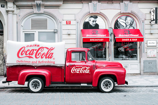 PRAGUE, CZECH REPUBLIC-MAY 15: Red retro car with Coca Cola advertising sign on board in the streets of Prague