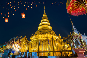 Loy Krathong Festival on twilight time and Floating lantern at Wat Phra That Hariphunchai Temple in Lamphun, Thailand