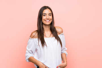 Young woman over isolated pink background laughing