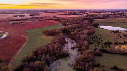 Poster Crimson Sunrise over a rural countryside wetland in Nebraska during autumn