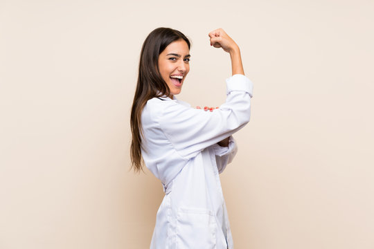 Young doctor woman over isolated background making strong gesture