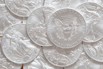 Poster Eagle Stack of silver coins american eagle top view