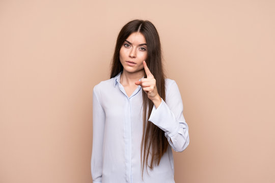 Young woman over isolated background frustrated and pointing to the front