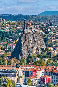 Saint-Michel d Aiguilhe rock with the Chapel in Puy-en-Velay town. Haute-Loir, Auvergne-Rhone-Alpes region in France.