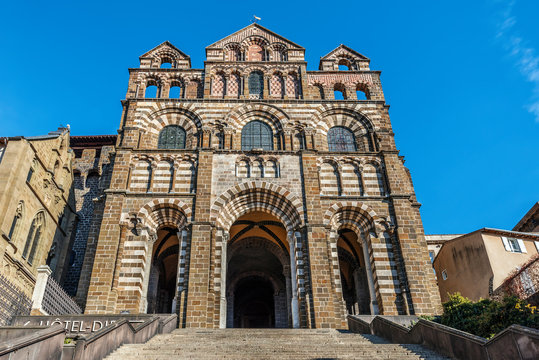 The facade of Le Puy Cathedral in Le Puy-en-Velay town. Haute-Loir department, Auvergne-Rhone-Alpes region in France.
