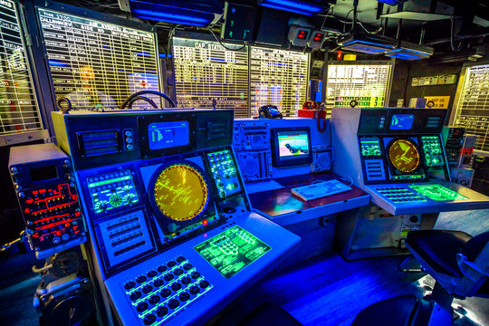 San Diego, Navy Pier, California, USA - JULY 31, 2018: Combat information center radar console, maps of Battleship Midway at San Diego, Navy Historic museum. Dark mode for combat operations.