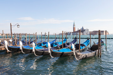 Foto op Canvas Gondolas Gondolas moored in St Marks Basin at San Marco in morning light with San Giorgio Maggiore in the background across the lagoon