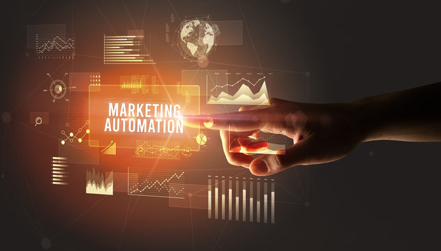 Hand touching MARKETING AUTOMATION inscription, new business technology concept