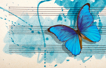 Fotorollo Schmetterlinge im Grunge Morpho blue butterfly and notes. Butterfly melody. Photo of old music sheet in blue watercolor paint. Blues music concept. Abstract blue watercolor background. copy spaces