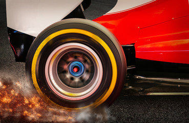 Formula 1 Rear wheel spinning and drifting after launch on a dark asphalt with smoke and dirt flying around