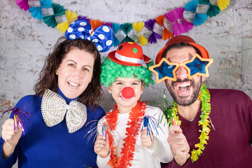 Foto op Canvas Carnaval Happy disguised family celebrating carnival at home.