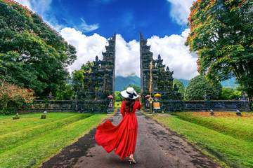 Papiers peints Bali Woman walking at big entrance gate, Bali in Indonesia.