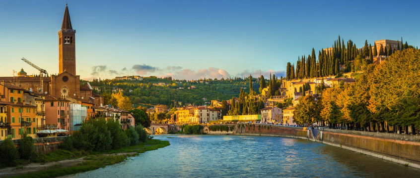 Verona cityscape during late sunset with Adige river and Church Complesso della Cattedrale-Duomo, viewed from the opposite side of river. Verona is located in Veneto, Italy,