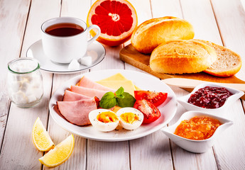 Continental breakfast on wooden table