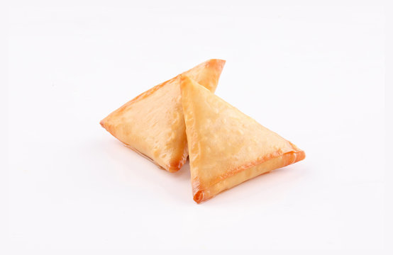 two Piece golden samosa on white background