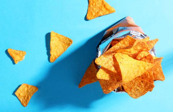 Bag chips doritos on blue background