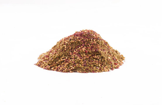 organic zaatar mIddle eastern spices on white background