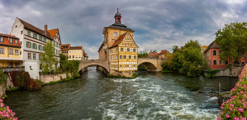 Altes Rathaus, a historical landmark building situated on an island accessible by pedestrian bridges, Bamberg, Germany. Fotomurales