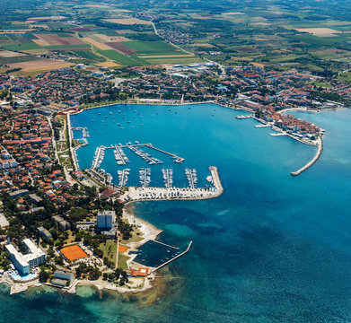 Old coastal city Umag in Croatia, aerial view. Istria, Europe.
