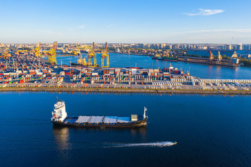 Helsinki. Finland. Barge is sailing a cargo port. Trading port in Helsinki. Cargo delivery to Finland by sea. Barge arrived to load. Imports of goods to Finland. Export and the European Union. Ship Wall mural