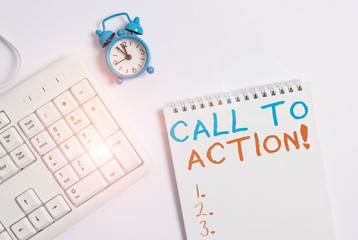 Writing note showing Call To Action. Business concept for exhortation do something in order achieve aim with problem Keyboard with empty note paper and pencil white background