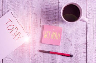 Writing note showing Act Now. Business concept for do not hesitate and start working or doing stuff right away Stationary placed next to a cup of black coffee above the wooden table