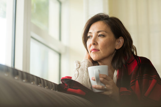 Portrait of a mature Asian woman in deep thought.