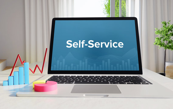 Self-Service – Statistics/Business. Laptop in the office with term on the Screen. Finance/Economy.