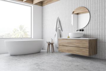 Loft white tile bathroom corner, tub and sink