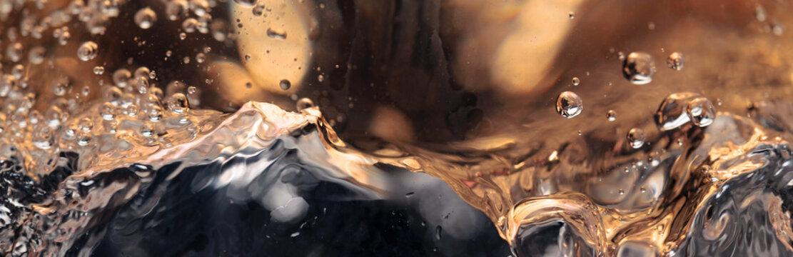 Abstract splashing of white wine.