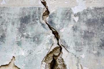 Big deep crack on an old brick wall. Several of deep cracked line. Close up. Papier Peint