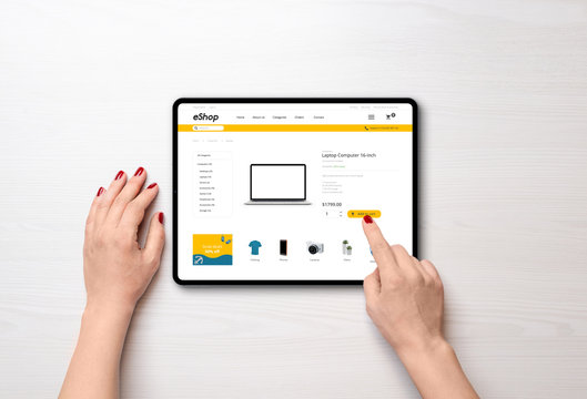 Shopping online with tablet. Modern online shop with grab deals banner on desk. Top view, falt lay