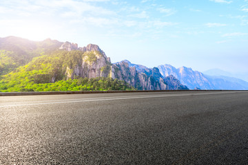 Asphalt highway and mountain with beautiful clouds landscape.