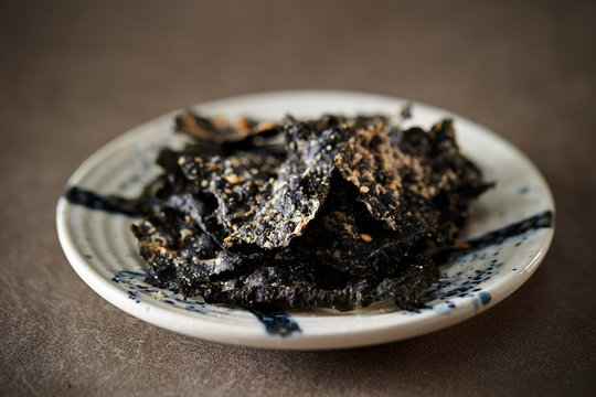 Seasoned seaweed snack on stone background