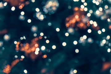 Fotobehang Bomen Christmas tree with decorations, christmas balls, light garlands, bokeh. Abstract blured festive background for design. Winter holiday, Happy New Year, xmas.