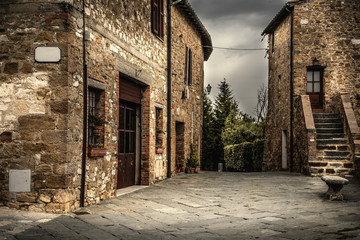 Fotobehang Oude gebouw Picturesque corner in a small town in Tuscany