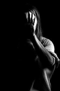 Woman showing gesture stop. Violence against women concept. Stop violence.