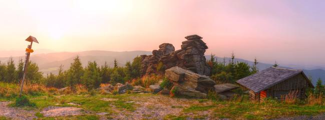 Foto auf Leinwand Rosa hell Panoramatic photo of big rocks at purple romantic sunset in Jeseniky Czech Republic