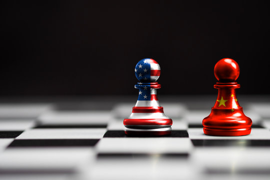 USA flag and China flag print screen on pawn chess with black background.It is symbol of tariff trade war tax barrier between United States of America and China.-Image.