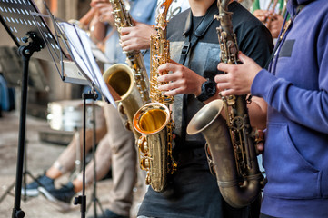 buskers. Saxophone, musical instrument played by saxophonist musicians.