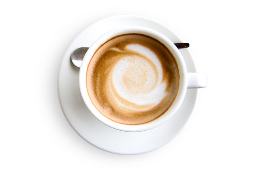 top view of coffee in a white ceramic cup and a spoon on white background with clipping path